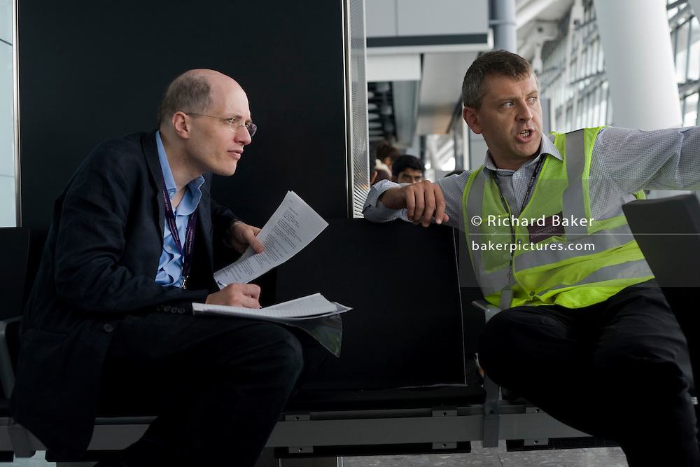 A member of British AIrways' Engineering explains technical jargon to author Alain de Botton while writing his Heathrow book.