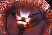 A Mountain Safety Research (MSR) XGK EX stove glows hot at a winter backcountry camp.