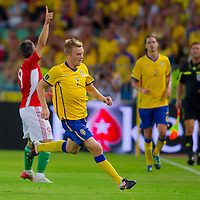 Sweden's Sebastian Larsson (C) runs for the ball as Hungary's Imre Szabics (L) signals the ball is out during the UEFA EURO 2012 Group E qualifier Hungary playing against Sweden in Budapest, Hungary on September 02, 2011. ATTILA VOLGYI