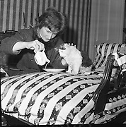 """Mrs. Beatrice Behan with 'Charlot"""" the tom cat, who is entered in a Cat Show at the Mansion House , Kildare Street, Dublin..03.04.1962"""