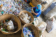 Woman sorting plastics according to their resin type at a small recycle project in Cianjur, West Java, Indonesia.
