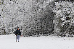 Hampstead Heath, London, January 17th 2016. Runners and dog walkers enjoy the early morning snow on Hampstead heath in London, where about an inch-and-a-half fell overnight.  PCTURED: A woman enjoys the snowy stillness on Hampstead Heath. ///FOR LICENCING CONTACT: paul@pauldaveycreative.co.uk TEL:+44 (0) 7966 016 296 or +44 (0) 20 8969 6875. ©2015 Paul R Davey. All rights reserved.