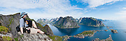 Above the Arctic Circle, ascend a slippery steep trail to Reinebringen for spectacular views of sharply glaciated peaks surrounding Reinefjord, on Moskenesøya (the Moskenes Island), Lofoten archipelago, Nordland county, Norway. Panorama stitched from 4 overlapping photos.