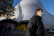 With local coronavirus lockdown measures in place and Birmingham currently set at 'Tier 2' or 'high', people, many of whom are wearing face masks near to the iconic Selfridges building in the city centre on 26th October 2020 in Birmingham, United Kingdom. The three tier system in the UK has levels: 'medium', which includes the rule of six, 'high', which will cover most areas under current restrictions; and 'very high' for those areas with particularly high case numbers. Meanwhile there have been calls by politicians for a 'circuit breaker' complete lockdown to be announced to help the growing spread of the Covid-19 virus.