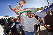 Nov. 22, 2009 -- PHOENIX, AZ: People dance in a style that is popular during the holiday of Holi, the Indian Festival of Colors, during the annual Discover India Festival in Phoenix, AZ. This is the 8th year the Indian Association of Phoenix has sponsored the festival, which started as a celebration of Diwali, the Indian Festival of Lights, and has since grown to be a celebration of India's cultures, traditions and diversity.    Photo by Jack Kurtz
