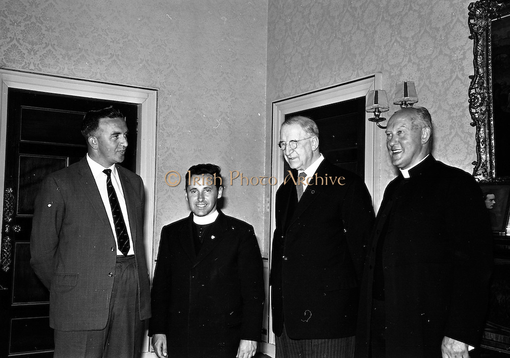 20/09/1963<br /> 09/20/1963<br /> 20 September 1963<br /> Rev. Fr. Raymond Browne, Chairman, Muintir na Tire visits President de Valera. before leaving to represent Ireland at the United Nations International Study Group at Leicester, England, Fr. Browne C.C. (Drumboylan, Co. Roscommon) was received by President Eamon de Valera at Aras an Uachtarain, Dublin.   Picture shows (l-r): Mr. Andy Roche, Director of Publicity, Muintir na Tire; Rev. Fr. Raymond Browne, Chairman; President de Valera and Very Rev. Fr. Maurice Morrissey, P.P. Kilteely, Co. Limerick.