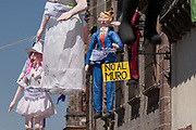 An effigy of U.S. President Donald Trump hangs in the Plaza Allende with other paper dolls in preparation for the Burning of Judas Easter-time ritual marking the end of Holy Week April 1, 2018 in San Miguel de Allende, Mexico. While the tradition includes burning a paper effigy of Judas a recent popular addition has been paper doll caricatures of Donald Trump across Mexico.