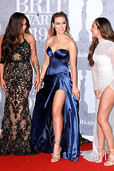 Jesy Nelson, Perrie Edwards and Jade Thirlwall of Little Mix attending the Brit Awards 2019 at the O2 Arena, London. Photo credit should read: Doug Peters/EMPICS Entertainment. EDITORIAL USE ONLY