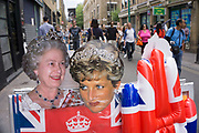 Postcards of the Queen and Princess Diana on Brick Lane, London, UK.