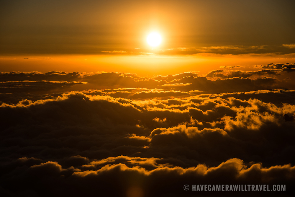 The sun sets above the clouds as seen from Arrow Glacier Camp (15,970 feet) on Mt Kilimanjaro.