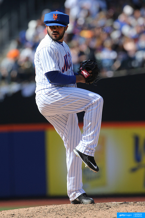 Pitcher Alex Torres, New York Mets, wearing protective head gear while pitching during the New York Mets Vs Miami Marlins MLB regular season baseball game at Citi Field, Queens, New York. USA. 19th April 2015. Photo Tim Clayton