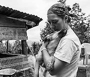 Marian McGraw, a canadian volunteer, cares for a puppy at the Aware shelter.