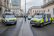 Security was unobtrusive with sniffer dogs on patrol and side streets blocked by police vans - The New Years day parade passes through central London form Piccadilly to Whitehall. London 01 Jan 2017