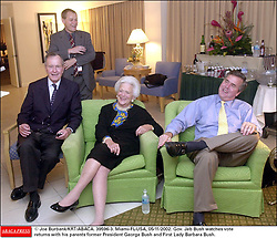 © Joe Burbank/KRT/ABACA. 39596-3. Miami-FL-USA, 05/11/2002. Gov. Jeb Bush watches vote returns with his parents former President George Bush and First Lady Barbara Bush.
