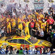 Sprint Cup Series driver Joey Logano (22) celebrates winning the 57th Annual NASCAR Daytona 500 race at Daytona International Speedway on Sunday, February 22, 2015 in Daytona Beach, Florida.  (AP Photo/Alex Menendez)