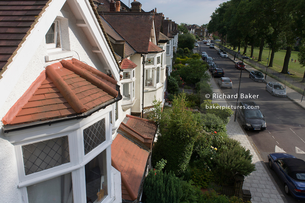 Aerial view of suburban Edwardian semi-detached houses in a south London street.