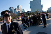 Police control well-wishers as they line up from early morning to be allowed to enter the Imperial Palace. Emperor Akihito 76th birthday was celebrated in Japan with a national holiday and thousands of well-wishers being allowed into the Royal Palace for the occasion. He made three appearances during the day and spoke of the economy difficulties many Japanese people are suffering during his address. He was accompanied by Empress Michiko, Crown Prince Naruhito, Prince Akishino and their wives. Tokyo, Japan December 23rd 2009