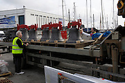 UK, Penzance - Monday, March 23, 2009: Project leader, John Maybrey, is filmed inspecting the bells prior to loading onto the Isles of Scilly Steamship Company's supply vessel the Gry Maritha to be transported to St Mary's on the Isles of Scilly. (Image by Peter Horrell / http://www.peterhorrell.com)