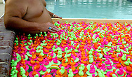 A member of the Ocean Pines Kiwanis holds back the plastic ducks used in the annual Kwanis duck races.