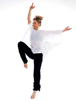 beautiful mature woman dancing modern ballet on isolated white background