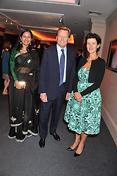 Left to right, GAURI AGARWAL, ROBIN WOODHEAD and MELANIE CLORE at the launch of the India Fantastique Exhibition and book launch featuring photographs by Ram Shergill and fashion by India's leading couturiers Abu Jani and Sandeep Khosla held at Sotheby's, 34-35 New Bond Street, London on 5th September 2012.