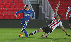 Jason Cummings of Peterborough United is tackled by Aaron Martin of Exeter City - Mandatory by-line: Joe Dent/JMP - 04/12/2018 - FOOTBALL - St James Park - Exeter, England - Exeter City v Peterborough United - Checkatrade Trophy