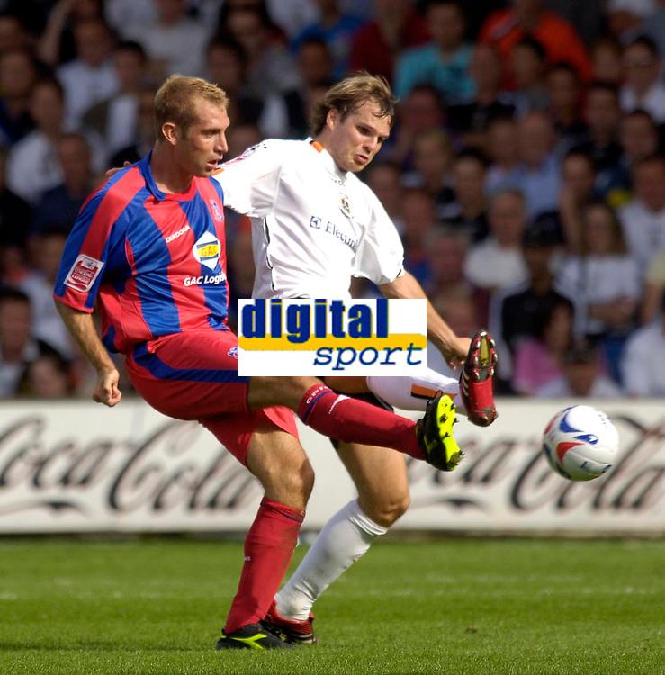 Photo: Daniel Hambury.<br />Luton Town v Crystal Palace. Coca Cola Championship. 09/09/2006.<br />Luton's Marcus Heikkinen and Palace's James Scowcroft battle.
