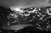 Susten Pass, Bern, Switzerland. June 2015. <br /> Susten Pass (German: Sustenpass) (el. 2262 m.) is a mountain pass in the Swiss Alps. The pass road, built from 1938–1945, connects Innertkirchen in the canton of Bern with Wassen in the canton of Uri. A 300 metres long tunnel crosses the pass at 2,224 metres.<br /> <br /> The pass is popular with tourists, especially for the views of the Stein Glacier on the south side.
