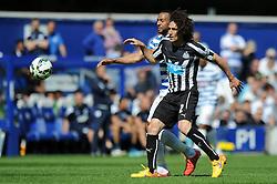 Queens Park Rangers' Karl Henry puts pressure on Newcastle United's Fabricio Coloccini - Photo mandatory by-line: Dougie Allward/JMP - Mobile: 07966 386802 - 16/05/2015 - SPORT - football - London - Loftus Road - QPR v Newcastle United - Barclays Premier League