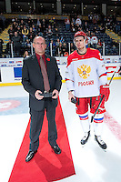 KELOWNA, CANADA - NOVEMBER 9: Artur Lauta #23 of Team Russia accepts the player of the game award from Richard Doerksen at the end of the game against the Team WHL on November 9, 2015 during game 1 of the Canada Russia Super Series at Prospera Place in Kelowna, British Columbia, Canada.  (Photo by Marissa Baecker/Western Hockey League)  *** Local Caption *** Artur Lauta;
