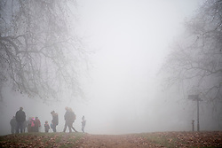 © Licensed to London News Pictures. 17/12/2016. London, UK. Horse riders Hyde Park in the fog.  Parts of the UK are swathed in thick fog this morning. Photo credit: Ben Cawthra/LNP