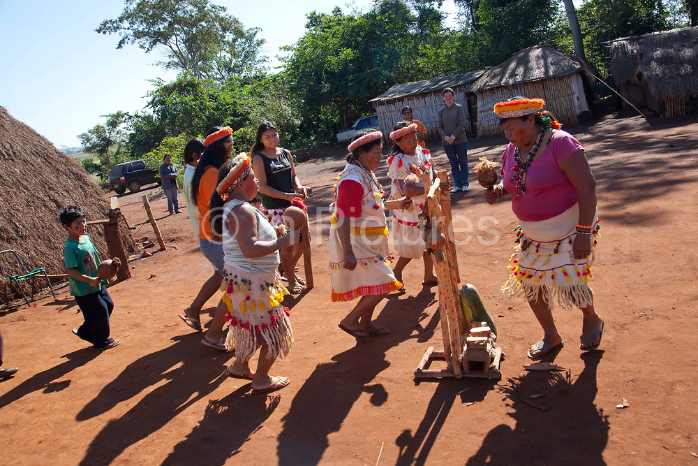 Guarani community showing a traditional dance. The Guarani are one of the most populous indigenous populations in Brazil, but with the least amount of land. They mostly live in the State of Mato Grosso do Sul and Mato Grosso. Their tradtional way of life and ancestral land is increasingly at risk from large scale agribusiness and agriculture. There have been recorded cases and allegations of violence between owners of large farms and the Guarani communities in this region.