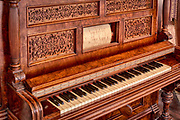 A player piano (also known as pianola or autopiano) is a self-playing piano, containing a pneumatic or electro-mechanical mechanism that operates the piano action via pre-programmed music perforated paper, or in rare instances, metallic rolls. The rise of the player piano grew with the rise of the mass-produced piano for the home in the late 19th and early 20th century. Sales peaked in 1924, then declined as the improvement in phonograph recordings due to electrical recording methods developed in the mid-1920s. The advent of electrical amplification in home music reproduction via radio in the same period helped cause their eventual decline in popularity, and the stock market crash of 1929 virtually wiped out production.
