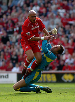 Photo. Glyn Thomas.<br /> Middlesbrough v Aston Villa. <br /> FA Barclaycard Premiership. 24/04/2004.<br /> Aston Villa's keeper Mark Schwarzer (R), who made a series of outstanding saves, clashes with Massimo Maccarone.