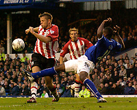 Photo. Jed Wee.<br /> Everton v Southampton, FA Barclaycard Premiership, Goodison Park, Liverpool. 19/10/03.<br /> Southampton's James Beattie (L) is foiled by a last ditch lunge from Everton's Joseph Yobo.