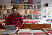 A man searching through vinyl records at Love Vinyl record shop in Shoreditch on the 29th March 2018 in East London in United Kingdom.