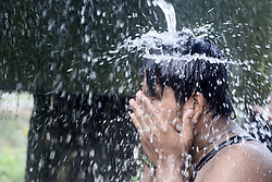 April 27, 2017 - Kolkata, West Bengal, India - People takes shower in water sources due to deadly heat wave all over the country. (Credit Image: © Saikat Paul/Pacific Press via ZUMA Wire)