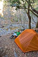 Reading the topo map at camp, Sykes Hot Springs, Big Sur, California.