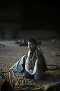 A homeless man under a flyover, New Delhi, India