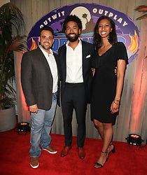 """Wendell Holland (center) - with Domenick Abbate and Laurel Johnson - is crowned the winner of """"Survivor: Ghost Island"""" at the season 36 finale celebration held at CBS Television Studios in Los Angeles, CA."""