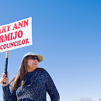 031213       Cable Hoover<br /> <br /> District 3 city council candidate Mary Ann Armijo lifts a sign above her head while campaigning outside the polling station at Jefferson Elementary School in Gallup Tuesday.