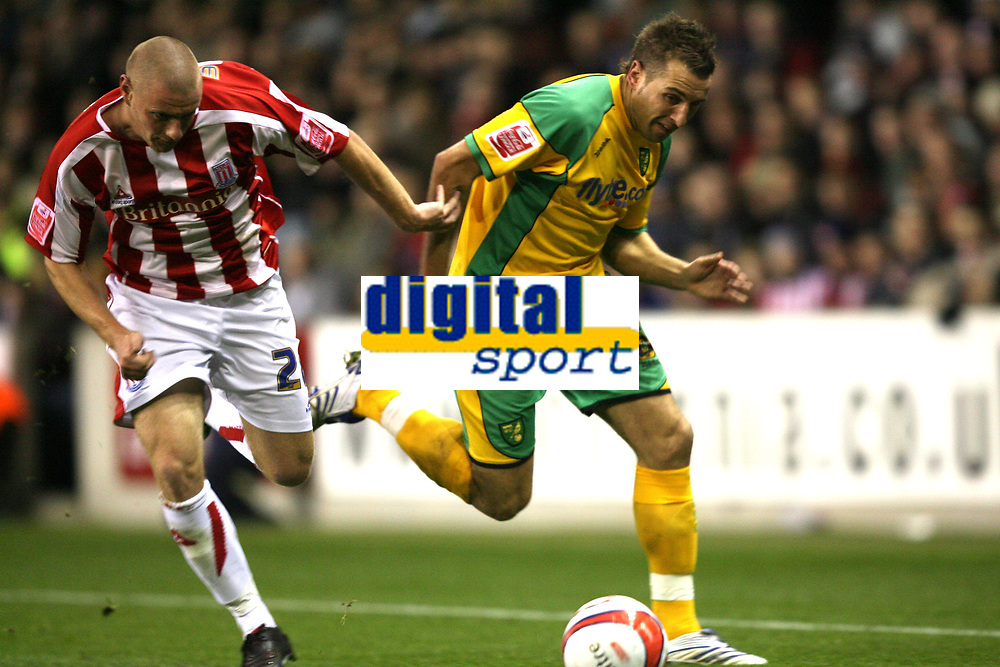 Photo: Paul Greenwood/Sportsbeat Images.<br />Stoke City v Norwich City. Coca Cola Championship. 01/12/2007.<br />Norwich's Darren Huckerby, (R) and Stoke's Rory Delap battle for the ball
