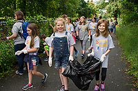 Pleasant Street School students from Mrs. Moore's and Mrs. Barbour's 5th grade class pick up trash along the WOW Trail as part of their Day of Caring with the United Way on Thursday morning.  (Karen Bobotas/for the Laconia Daily Sun)