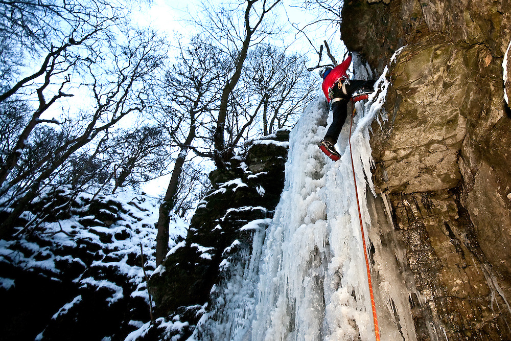 Ed Chard Climbing at The Waterfall Swallet near Eyam, Derbyshire, Peak District National Park, England, UK