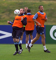 Photo. Jed Wee.<br /> England Training, England v Liechtenstein, European Championship Qualifier, The Cliff, Manchester. 09/09/2003.<br /> England's Wayne Rooney (L) looks to build on his first international goal.