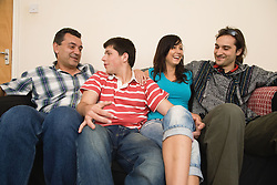 Group of Czech and Bulgarian friends in a shared house relaxing on the sofa,