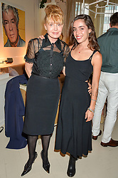 Left to right, LYNDALL HOBBS and her daughter LOLA ROSE THOMPSON at a party to celebrate the publication of 'A Girl From Oz' by Lyndall Hobbs held at Flat 1, 165 Cromwell Road, London on 12th May 2016.