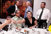BETHLEHEM, PA – JUNE 17, 2011: Hispanic businessman Octavio Pena (left, seated) celebrates with his wife and friends at a cocktail party in Bethlehem, Pennsylvania.<br /> <br /> As the population of second and third generation Hispanics increases dramatically in the United States, a new boldness can be sensed among Latinos in America, stretching far beyond the southern border states. Demographers in Pennsylvania say the towns of Bethlehem, Allentown and Reading are set to become majority-minority cities, where Hispanics comprise a bigger portion of the population than whites. As this minority population increases dramatically in the region, Latinos are inching closer to their own realization of the American Dream, while gradually shifting the physical and cultural landscapes of their communities.