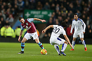 Jordan Veretout of Aston Villa (l) looks to go past Shinji Okazaki of Leicester city. Barclays Premier league match, Aston Villa v Leicester city at Villa Park in Birmingham, The Midlands on Saturday 16th January 2016.<br /> pic by Andrew Orchard, Andrew Orchard sports photography.