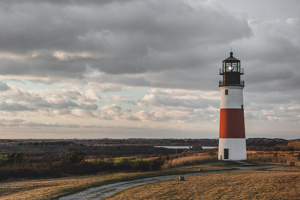 Sankaty Head Lighthouse shining in the warm glow of an autumn sunset on the eastern edge of Nantucket.